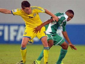Musa Yahaya challenges for the ball with Erdal Rakip of Sweden during the FIFA U17 group F match between Sweden and Nigeria at Khalifa Bin Zayed Stadium on October 22, 2013 in Al Ain, United Arab Emirates.  (Photo by  FIFA)
