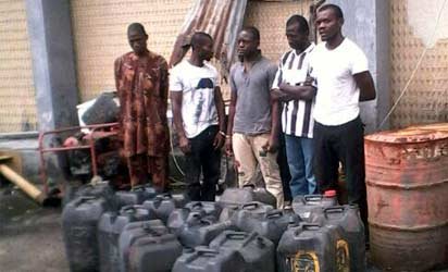 Sani Musa (middle) and the other suspects.