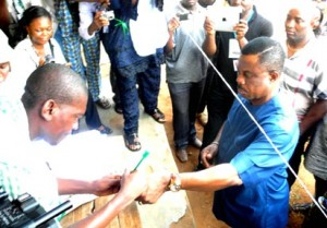 ANAMBRA APGA GOVERNORSHIP CANDIDATE, CHIEF WILLIE OBIANO, BEING ACCREDITED BY INEC OFFICIALS AT ERI PRIMARY SCHOOL CENTRE,FOR 2013 ANAMBRA GUBERNATORIAL ELECTION AT OTUOCHA WARD ONE ON SATURDAY (16/11/13). PHOTO: NAN