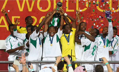 Akinjide Idowu (C) of Nigeria and his team-mates celebrate their victory with the trophy during the FIFA World Cup UAE 2013 Final between Nigeria and Mexico at Mohamed Bin Zayed Stadium on November 8, 2013 in Abu Dhabi, United Arab Emirates. (Photo FIFA)