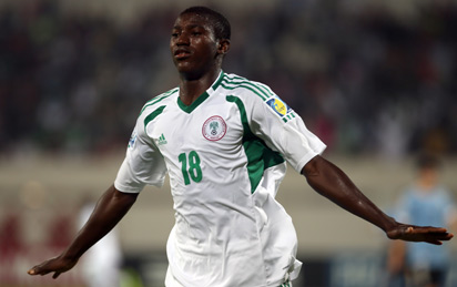 Taiwo Awonity of Nigeria celebrates after scoring against Uruguay during his FIFA U-17 World Cup UAE 2013 football match in Sharjah on November 2, 2013. AFP PHOTO / STR