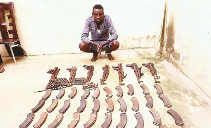 Godogodo with  some of his arsenal