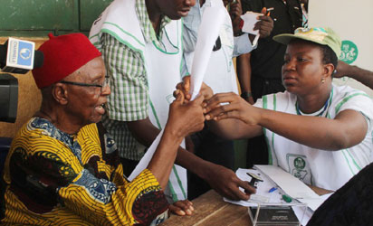 85 year old Chief Michael Iwoba, a pensioner being accredited to vote at Eri Primary School, Aguleri.
