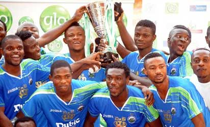 Players of Eyinmba Fc jubilating with the trophy after Winning the Super 4 2013/2014 Glo Pre-season League Tournament Cup in Abuja on Tuesday (28/1/14). Eyinmba defeated Kano Pillars 1-0 at the final. /Nan
