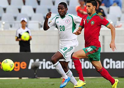 Mohamed Oulhaj of Morocco gets to the ball ahead of Ifeanyi Ede of Nigeria during the 2014 CAF African Nations Championships quarterfinal football match between Morocco and Nigeria at Cape Town Stadium, Cape Town on 25 January 2014