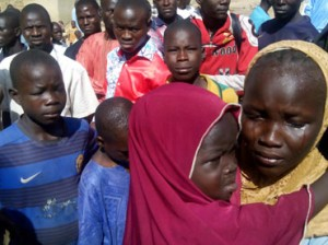 DISPLACED—Tears during  Governor Kashim Shettima visit  to some of the displaced residents of Izge village stranded in Gulak, Madagali Council Area of Adamawa State, yesterday, after the Boko Haram attack that claimed the lives of over 121 persons. Photo Ndahi Marama.