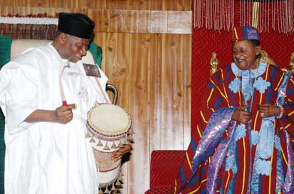 President Goodluck Jonathan on the talking drum presented to him by the Alafin of Oyo Oba Lamidi Olayiwola Adeyemi(iii)  in his Palace in Oyo yesterday.