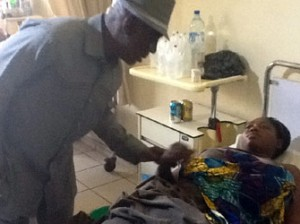 TRAGEDY: Interior Minister, Abba Moro, with one of the victims of Nigeria Immigration Service aptitude test tragedy, at the National Hospital, Abuja, yesterday.