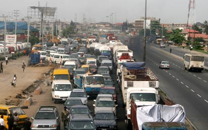Standstill at Mile-2 to Tincan, along Oshodi-Apapa expressway as a result of Fuel tanker Illegal parking on the road, the journey of 5mins torus to 7 hour, yesterday. Photo: Joe Akintola, photo editor.