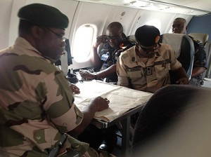 File photo strategizing: The Chief of Army Staff, Lt-Gen Kenneth Minima (left); his Air Force counterpart, Air Marshal Adesola Amosu (middle) and General Officer Commanding 3rd Division, Nigerian Army, Maj. Gen John Zaruwa, aboard a Nigerian Air Force plane strategising with the aid of maps in the ongoing counter-terrorist operations in Borno, Yobe and Adamawa states, during a visit to the area, weekend.