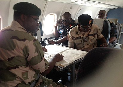 strategizing: The Chief of Army Staff, Lt-Gen Kenneth Minima (left); his Air Force counterpart, Air Marshal Adesola Amosu (middle) and General Officer Commanding 3rd Division, Nigerian Army, Maj. Gen John Zaruwa, aboard a Nigerian Air Force plane strategising with the aid of maps in the ongoing counter-terrorist operations in Borno, Yobe and Adamawa states, during a visit to the area, weekend.