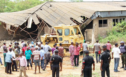 Demolition of the kidnappers' den at Soka forest, Lagos-Ibadan Expressway, as ordered by Oyo State government, began yesterday. PHOTOS: Dare Fasube.