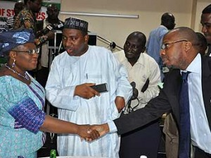 *Briefing on Result of GDP in Nigeria: Minister of Finance and Coordinating Minister of Economy, Dr. Ngozi Okonjo –Iweala chatting with Minister of National Planning Amb. Bashiru Yuguda  and Statistician –General of the Federation and CEO of National Bureau of Statistics Dr. Yemi Kale during presentation of Preliminary Results of the Rebased Nominal Gross Domestic Product ( GDP) Estimates from Nigeria 2010 to 2013 held in Abuja. Photo by Gbemiga Olamikan.