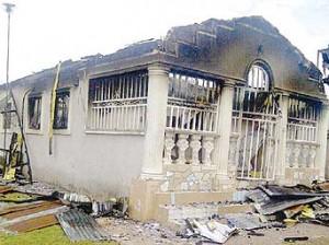 *The house razed during mayhem