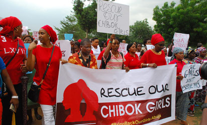 Abuja : Former Nigerian Education Minister and Vice-President of the World Bank's Africa division (3r L) Obiageli leads a march of Nigeria women and mothers of the kidnapped girls of Chibok, calling for their freedom in Abuja on April 30, 2014.