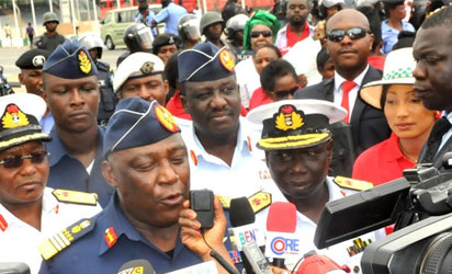 CHIBOK—The Chief of Defence Staff, Air Chief Marshal Alex Badeh (L), speaking during a protest over abducted Chibok school girls in Abuja, yesterday.