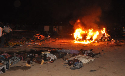 THE BLAST —Scene of the blast in Abuja, yesterday. Photos: Emma Ujah & Gbemiga Olamikan.