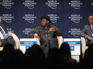 WEFA—President Goodluck Jonathan (C) speaks, flanked by WEF founder Klaus Schwab (L) and Rwandan President Paul Kagame (R), during the World Economic Forum in Abuja, yesterday. Photo: AFP.