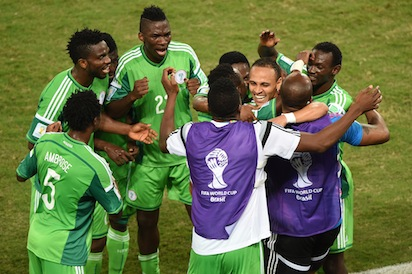 Nigeria's forward Peter Odemwingie (3rd-R) celebrates with teammates after scoring a goal during the Group F football match between Nigeria and Bosnia-Hercegovina at the Pantanal Arena in Cuiaba during the 2014 FIFA World Cup on June 21, 2014.  AFP PHOTO /
