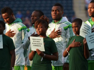 UNITED STATES, CHESTER : CHESTER, PA - JUNE 3: The player escorts for the Nigerian National Team hold signs in support of the girls kidnapped in Nigeria, before the game against Greece during an international friendly match at PPL Park on June 3, 2014 in Chester, Pennsylvania. AFP