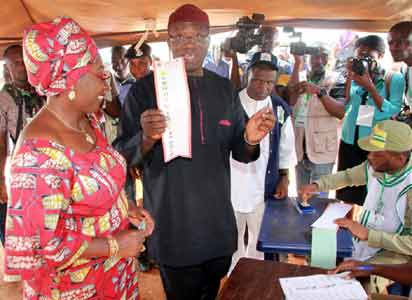 Governorship Candidate, All Progressives Congress, APC, Dr Kayode Fayemi; with his wife, Erelu Bisi Fayemi, on the verge of casting their votes at Ogilolo Ward, Isan-Ekiti... on Saturday.