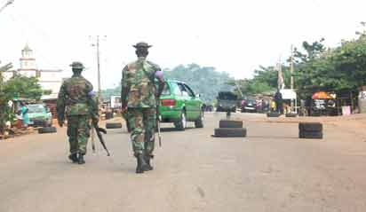 two soldiers maning a road block along Ado-Iyin Ekiti road. Pic by Dare Fasube
