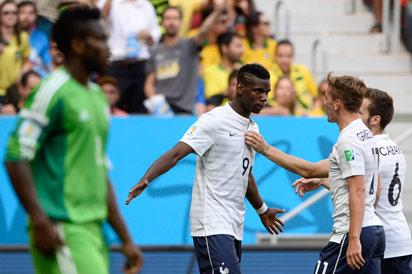 France's midfielder Paul Pogba (C) celebrates with teammates after scoring a goal during the round of 16 football match between France and Nigeria at the Mane Garrincha National Stadium in Brasilia during the 2014 FIFA World Cup on June 30, 2014.  AFP PHOTO .