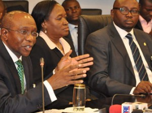 New CBN Governor— From left, new CBN Governor, Mr Godwin Emefiele, his deputies, Sarah Alade and Adebayo Adelabu during a World Press Conference in Abuja, yesterday. Photo: Gbemiga Olamikan. See story on Page 8