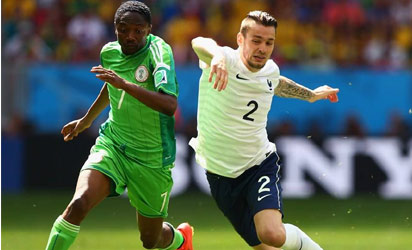 Nigeria's Ahmed Musa and France's Mathieu Debuchy vie for the ball in Brasilia.