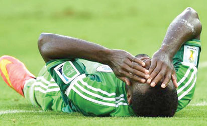 DOWN AND OUT: Godfrey Oboabona writhing in pains during the match against Iran. He is out of the World Cip