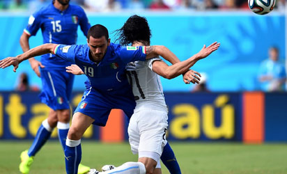 NATAL, BRAZIL : Edinson Cavani of Uruguay and Leonardo Bonucci of Italy compete for teh ball during the 2014 FIFA World Cup Brazil Group D match between Italy and Uruguay at Estadio das Dunas on June 24, 2014 in Natal, Brazil. (Photo by Shaun Botterill - FIFA/FIFA)