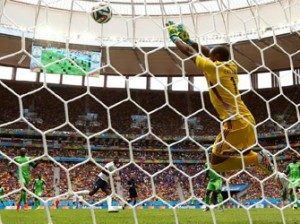Nigeria goalkeeper Vincent Enyeama saves a shot by Paul Pogba of France.