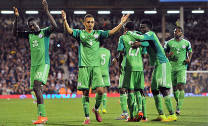 THANK YOU ALL . . . Super Eagles' striker Peter Odemwingie (2ndL) thanks the fans after their international friendly match against Scotland at Craven Cottage in London ahead of the FIFA World Cup . Photo: AFP