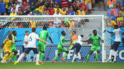 Paul Pogba of France scores his team's first goal on a header past goalkeeper Vincent Enyeama of Nigeria during the 2014 FIFA World Cup Brazil Round of 16 match between France and Nigeria at Estadio Nacional on June 30, 2014 in Brasilia, Brazil. (FIFA)