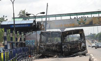 Some of  BRT Buses put on fire by  army of the killing one of them by BRT Driver at Palmgrove,  bus-stop on Friday 4-7-2014, PHOTO; Kehinde Gbadamosi