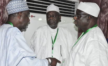 Confab: From left, Alh. Umaru Hadejima discussing with Senator Shaidu Dansadau and Dr Garba Abari  during Consideration of Devolution of Power Committee's Report at National Confab in Abuja. Photo by Gbemiga Olamikan
