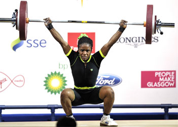 GOLDEN GIRL . . . Nigeria's gold medalist Chika Amalaha competing in the women's weightlifting 53kg class, at the SECC Precinct during the 2014 Commonwealth Games in Glasgow, Scotland, Photo: AFP PHOTO