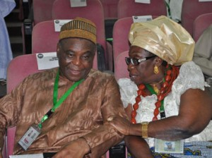 From left, Chief Raymod Dopkesi discussing with Chief Mrs. Sani Felicia on Monday  during Consideration of Devolution of Power Committee's Report at National Confab in Abuja. Photo by Gbemiga Olamikan.