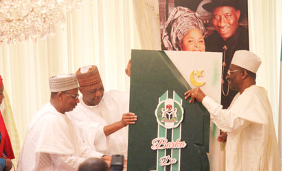 President Goodluck Jonathan (r) receiving a greeting card from Vice President Namadi Sambo; FCT Minister, Senator Bala Mohammed and the Minister of State FCT, Oloye Olajumoke Akinnjide during Eid-il-Fitri homage paid the President by residents of the FCT led by Vice President Namadi Sambo at the President's Residence, State House, Abuja. Photo by Abayomi Adeshida