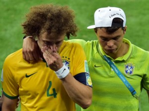 Brazil's defender David Luiz (R) is consoled by Brazil's defender and captain Thiago Silva after losing the semi-final football match between Brazil and Germany at The Mineirao Stadium in Belo Horizonte on July 8, 2014, during the 2014 FIFA World Cup.     AFP PHOTO / GABRIEL BOUYS