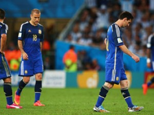 Lionel Messi of Argentina (R) looks dejected after a goal during the 2014 FIFA World Cup Brazil Final match between Germany and Argentina at Maracana on July 13, 2014 in Rio de Janeiro, Brazil. (Photo by FIFA