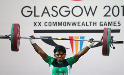GOOD LIFT: Obioma Okoli competes in the 63kg women's weightlifting event at the Commonwealth Games. She won a silver medal for Nigeria.