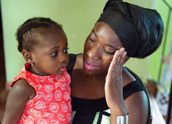 Late  Ebola virus disease victim, Patrick Sawyer's wife, Decontee with her daughter