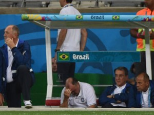 Brazil's coach Luiz Felipe Scolari (L) reacts during the semi-final football match between Brazil and Germany at The Mineirao Stadium in Belo Horizonte on July 8, 2014, during the 2014 FIFA World Cup.  AFP PHOTO / PEDRO UGARTE