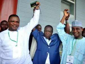 BEFORE THE CRACK: Dr. Rafiu Ladipo (m) raises the hands of Chief Mike Umeh (l) and Aminu Maigari after their election in 2010.