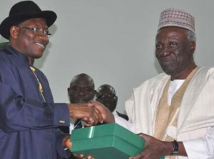 Confab Closes— From left: President Goodluck Jonathan receiving Report of 2014 National Conference from  Chairman of the Confab, Justice Idris Kutigi at the closing ceremony of conference in Abuja, yesterday. Photo: Gbemiga Olamikan.