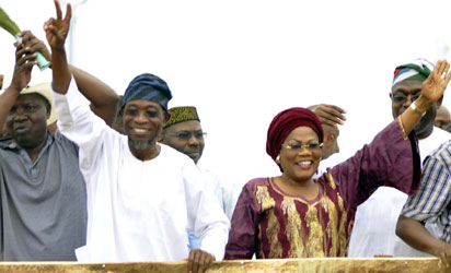 Governor Rauf Aregbesola of Osun State (2nd left) and his deputy, Mrs Titi Laoye-Tomori celebrating their re-election at Freedom Park, Osogbo, yesterday. Photo: Dare Fasube.