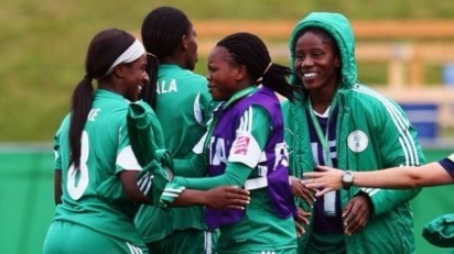 Courtney Dike (L) of Nigeria celebrates her team's first goal with team mates during the FIFA U-20 Women's World Cup Canada 2014 group C match between Korea Republic and Nigeria at Moncton Stadium on August 9, 2014 in Moncton, Canada. (Photo FIFA)