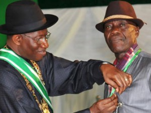 President Goodluck Jonathan (L), presenting a 'Member of the Order of the Federal Republic (MFR)' Award To A Taxi Driver, Mr Imeh Usuah, who returned the sum of N18m (Eighteen Million Naira) forgotten in his car by a customer, in Abuja on Monday (29/9/14).