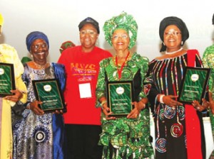 """First Lady of Lagos State and Chairman, Committee of Wives of Lagos State Officials (COWLSO), Dame Emmanuella Abimbola Fashola (3rd left) with the awardees: Iya Oge of Lagos, Chief Opral Benson (3rd right); Iyalode of Lagos, Hajia Bintu Tinubu (2nd right); Mrs. Wonu Folami (2nd left); Mrs. Feyintola Muri-Okunola (left) and former Special Adviser on Central Business District, Mrs. Derin Disu (right) during the opening ceremony of the 2014 National Women Conference with the theme, """"Embracing and Managing Change"""", organised by the Committee of Wives of Lagos State Officials (COWLSO) in Lagos."""